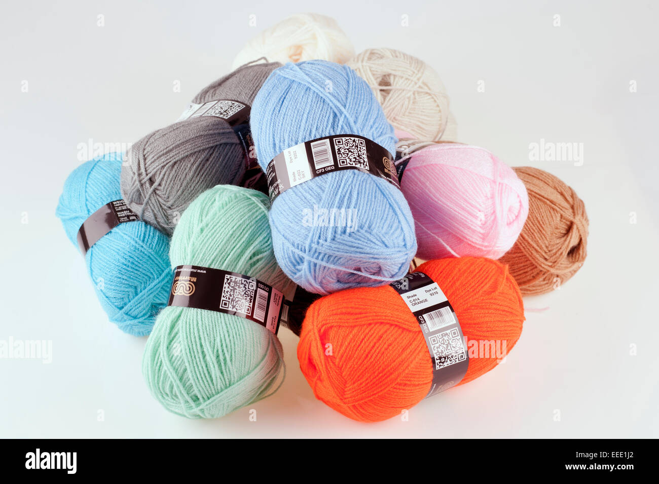 Pile of different coloured balls of double knitting wool - Stock Image