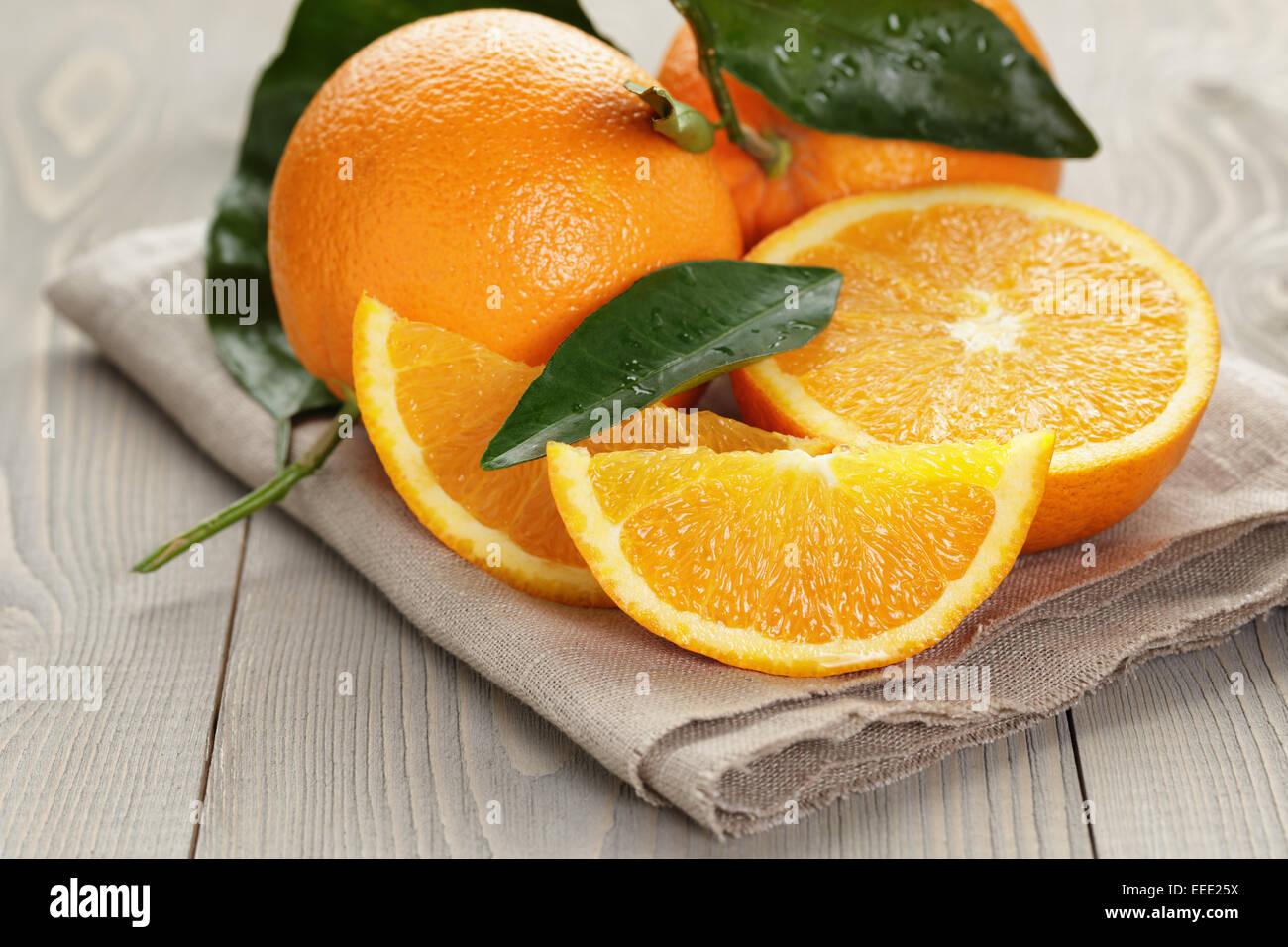 ripe spanish oranges on wood table, rustic photo - Stock Image
