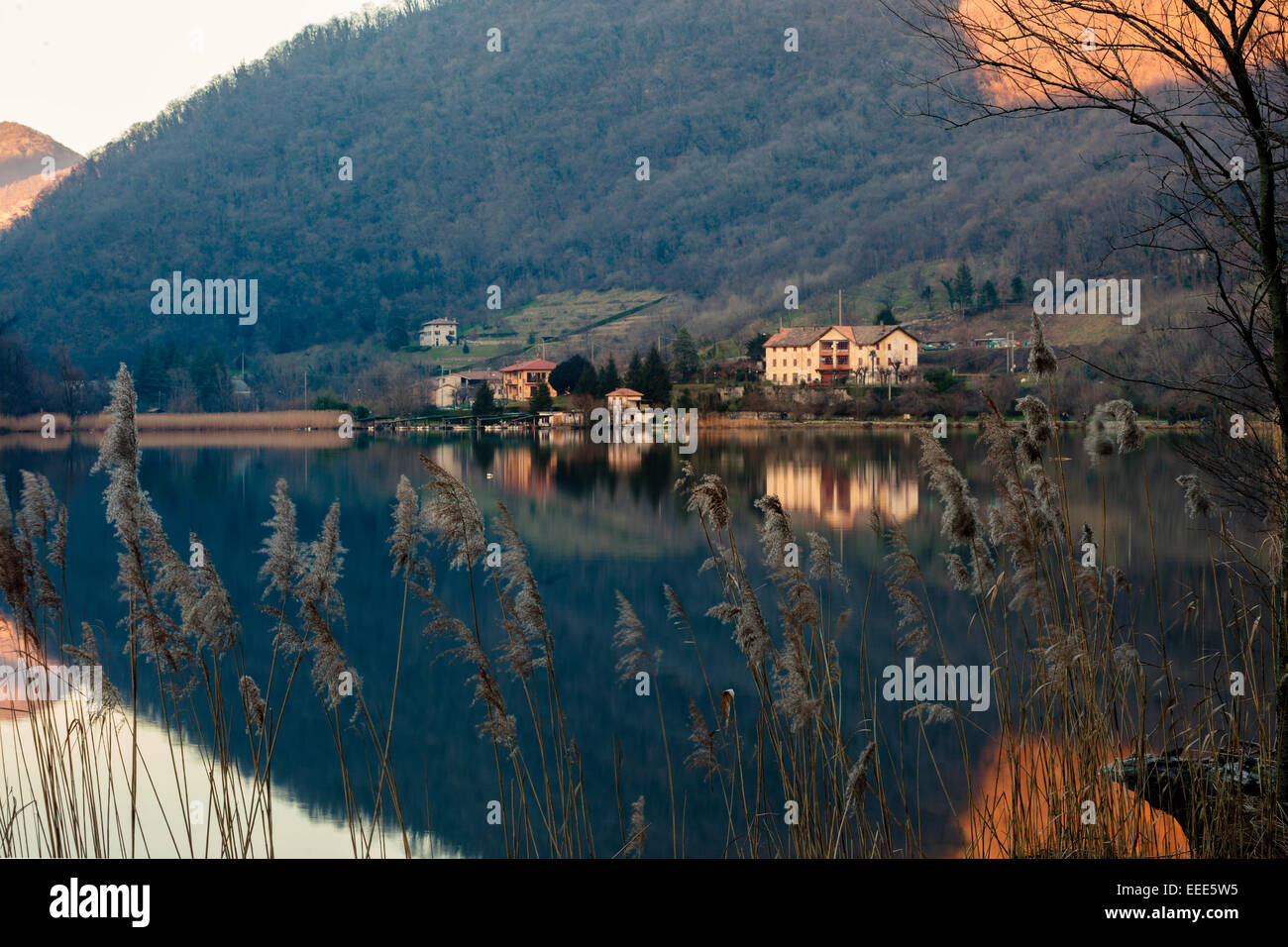 Waterscape reflection taken during sunset. The whole image seems a spearhead. Lombardia. Italy - Stock Image