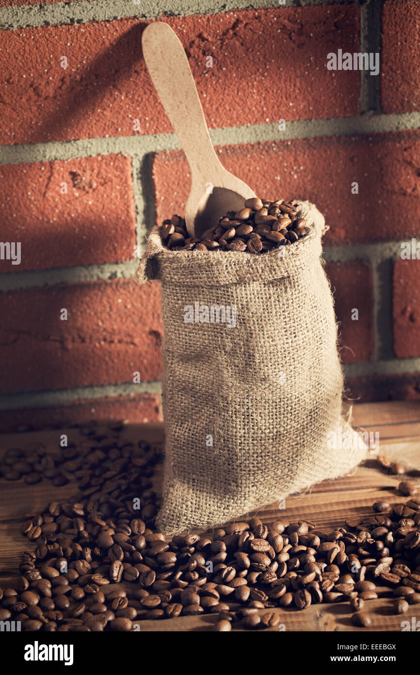the coffee beans in sack - Stock Image