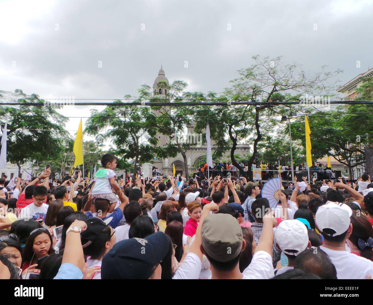 Thousands of Catholic devotees, who patiently waited for long hours, greeted Pope Francis with loud cheers as he - Stock Image