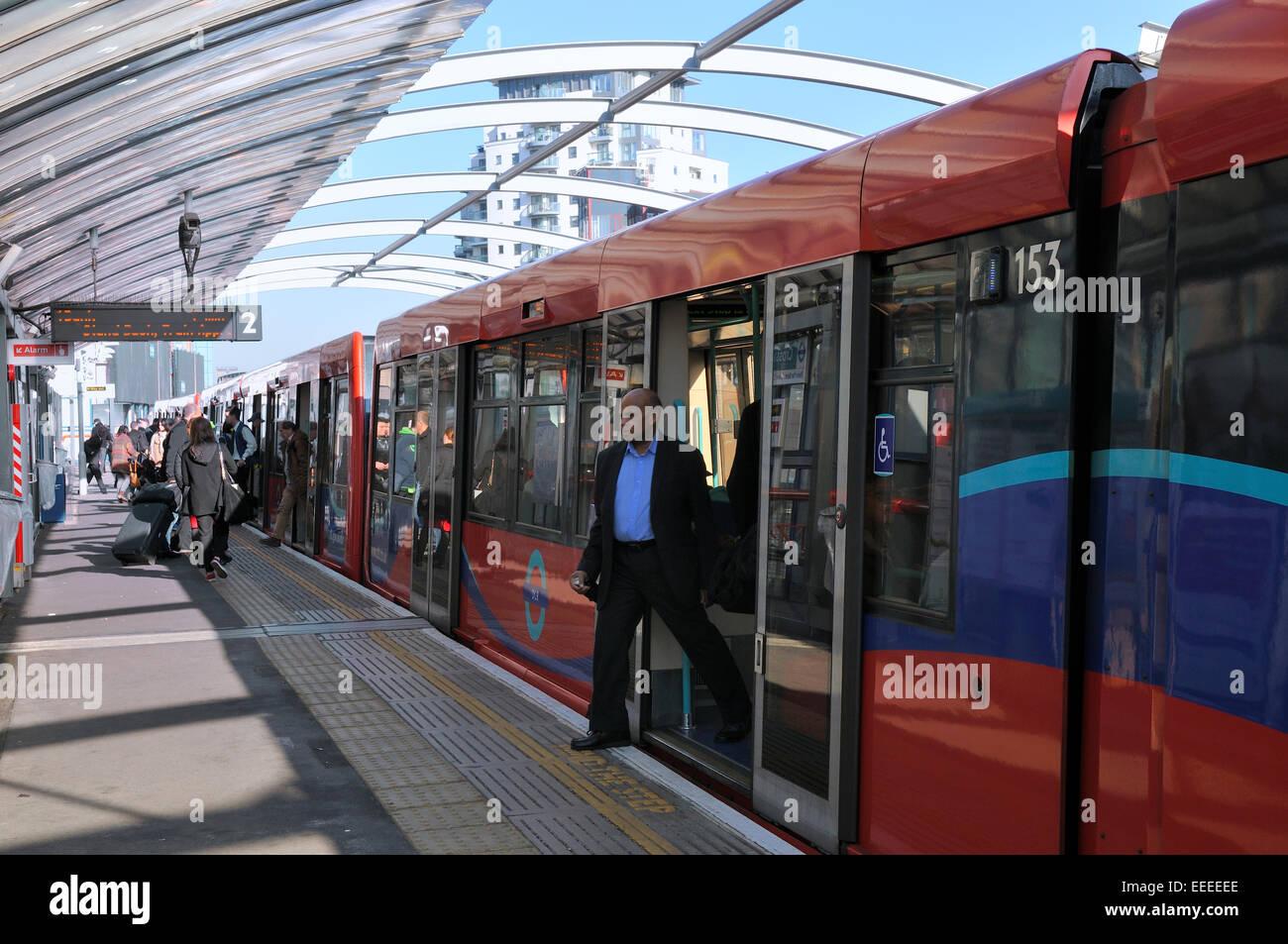 London Crossharbour station with Docklands Light Railway (DLR) train at platform - Stock Image