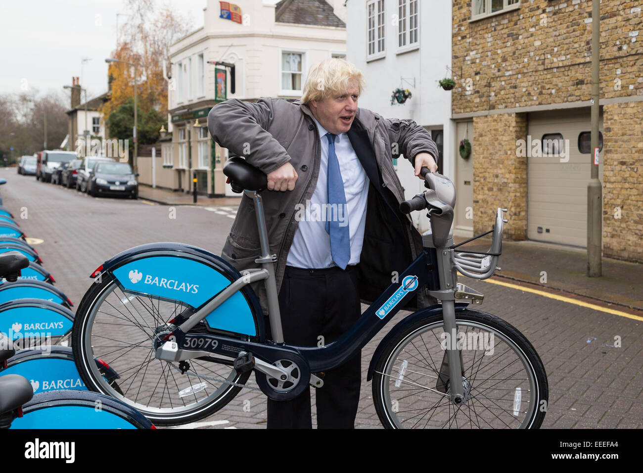 London Mayor Boris Johnson with a hire bike - Stock Image