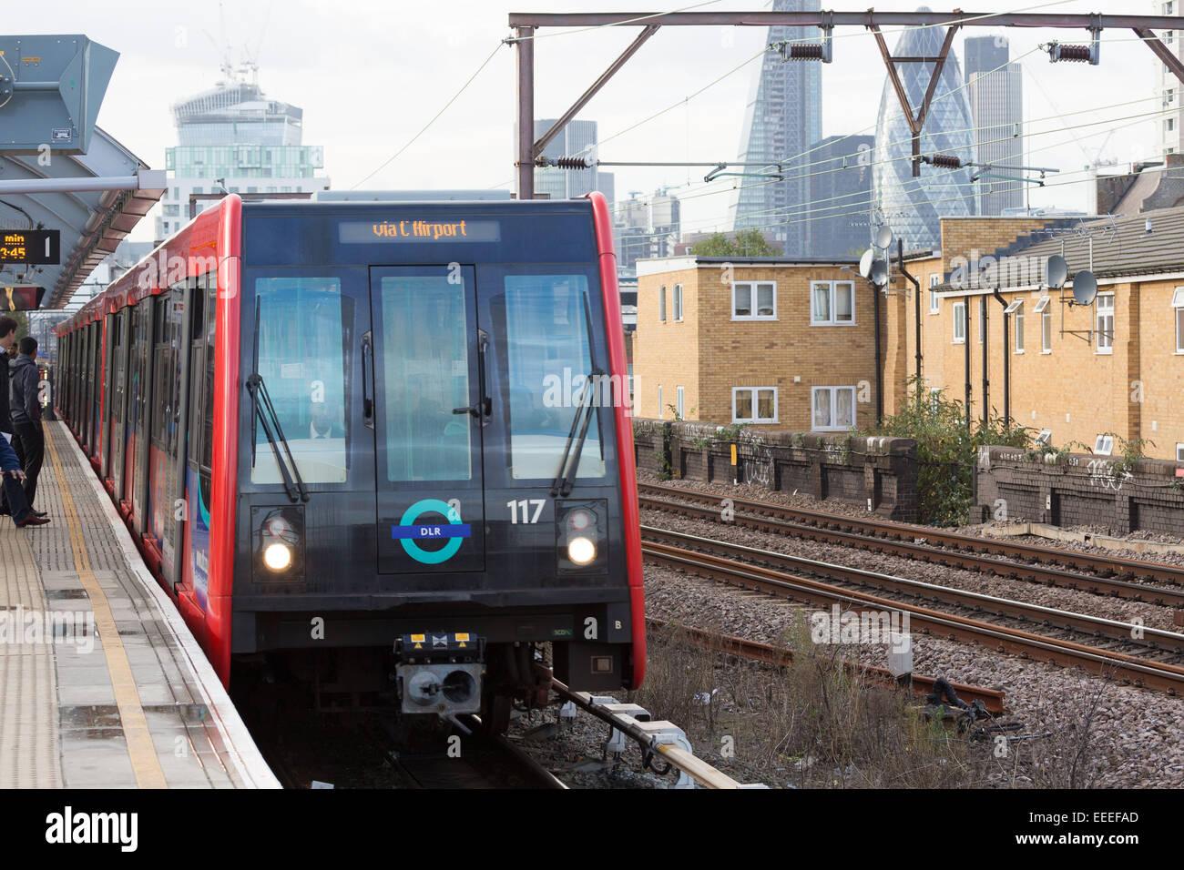 Docklands Light Railway train with London skyline - Stock Image