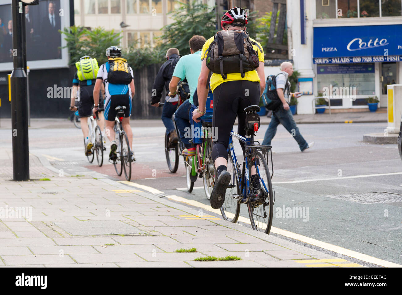 Cyclists using a cycle lane on Bayliss Road - Stock Image