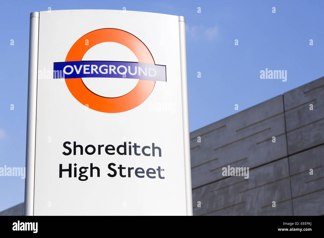 Overground roundel for Shoreditch High Street - Stock Image