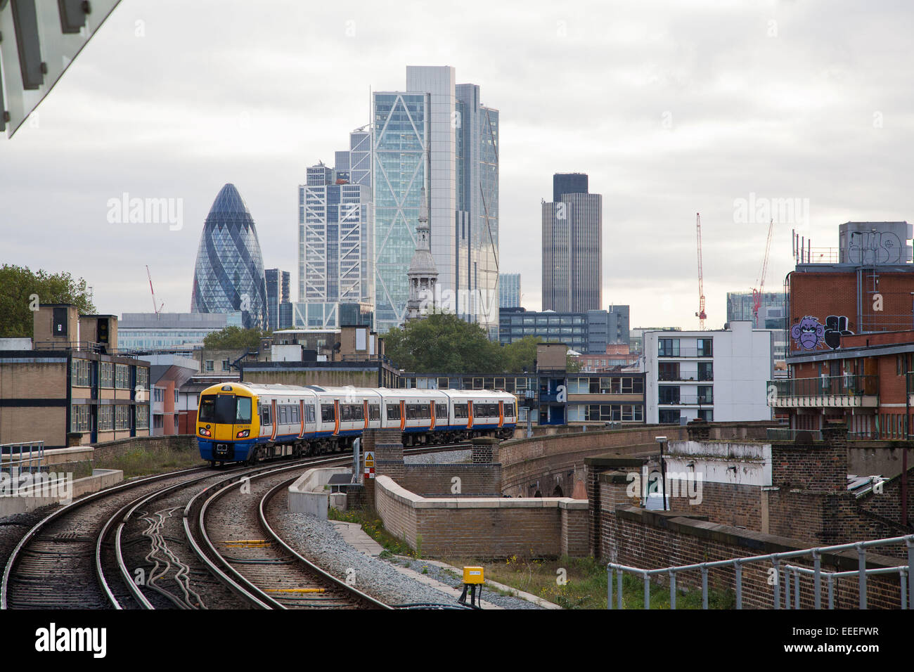 View of the London skyline with an Overground train - Stock Image
