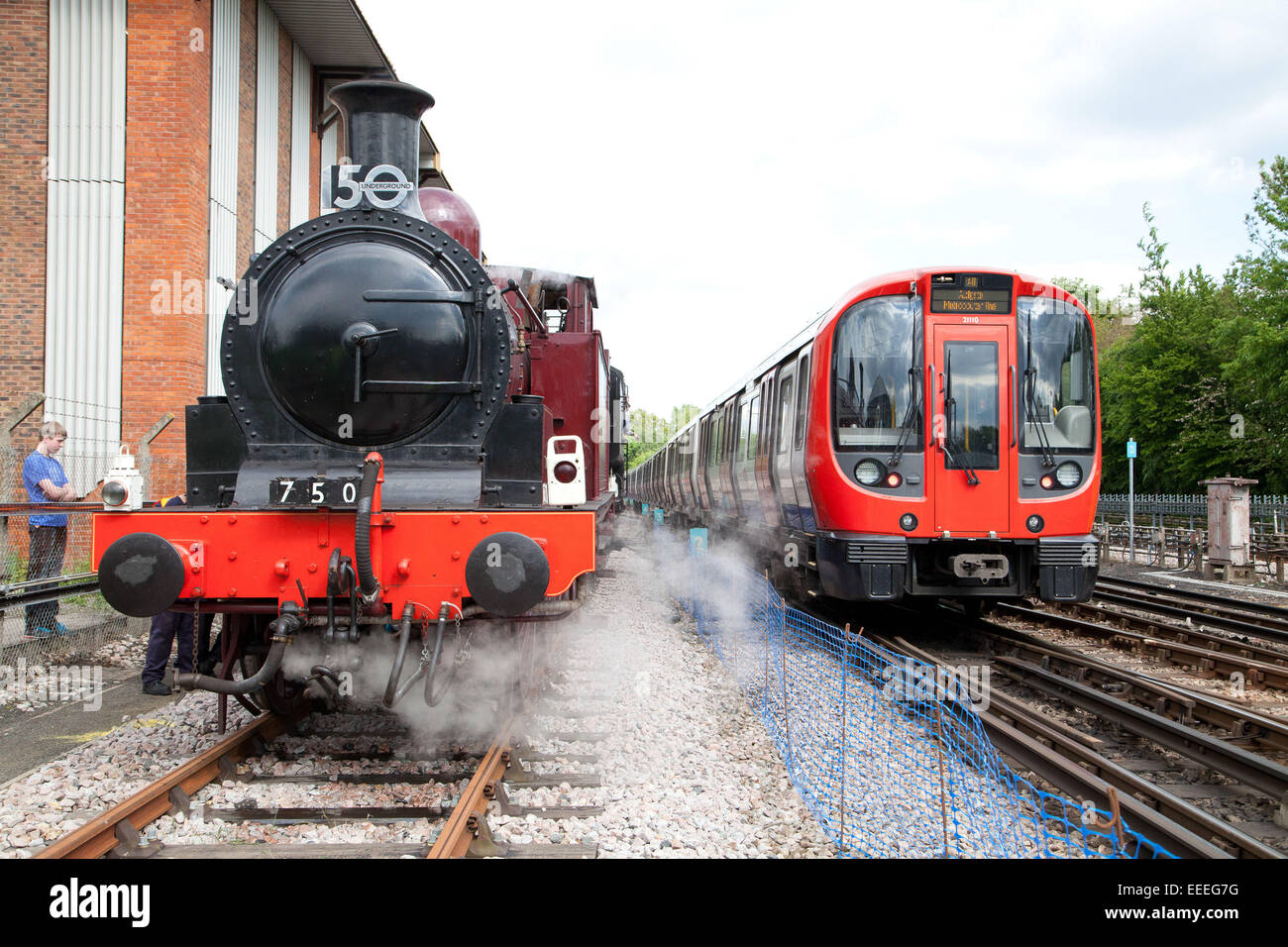 The new S Stock Metropolitan line train meets Metropolitan 1 outside of Amersham station during the Tube 150 Years - Stock Image