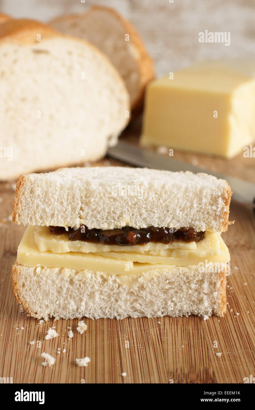 Hand cut Cheddar cheese and pickle sandwich made with home made bread - Stock Image