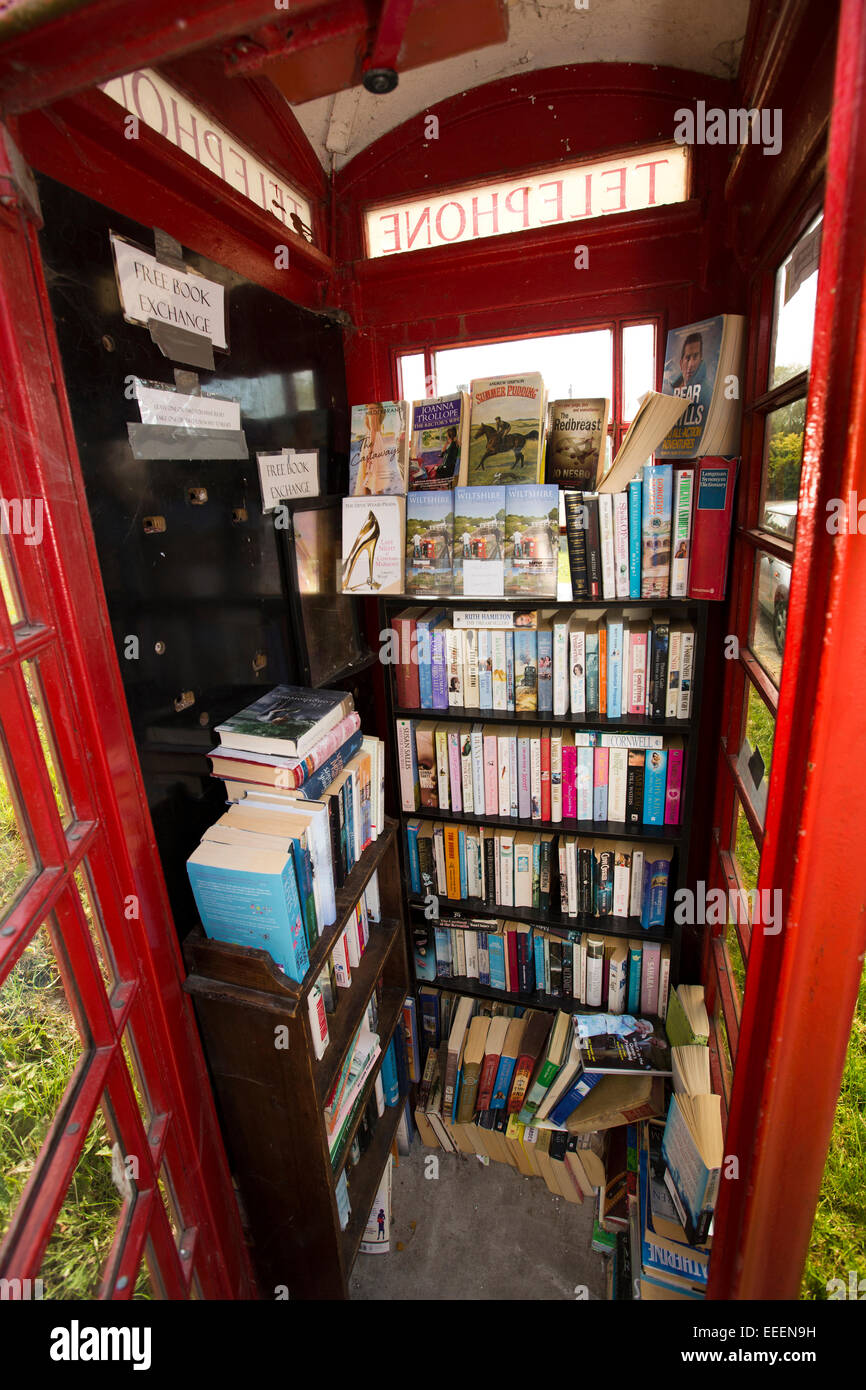 UK, England, Wiltshire, Vale of Pewsey, All Cannings, The Street, village K6 phone box used as book exchange - Stock Image