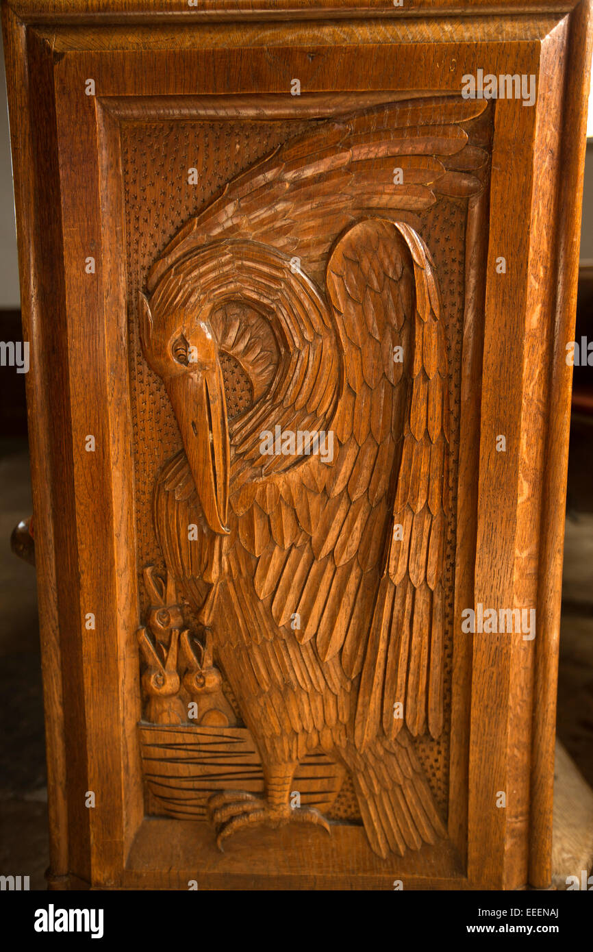 UK, England, Wiltshire, Bishop Cannings, St Mary the Virgin Church, pelican in her piety carved pew end - Stock Image
