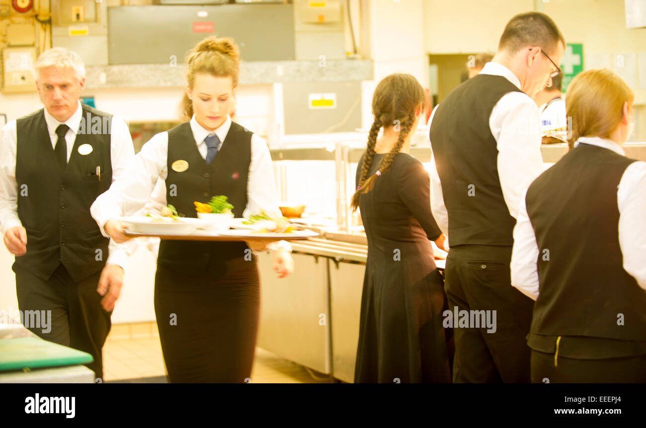 Chefs and kitchen staff working in a busy kitchen - Stock Image