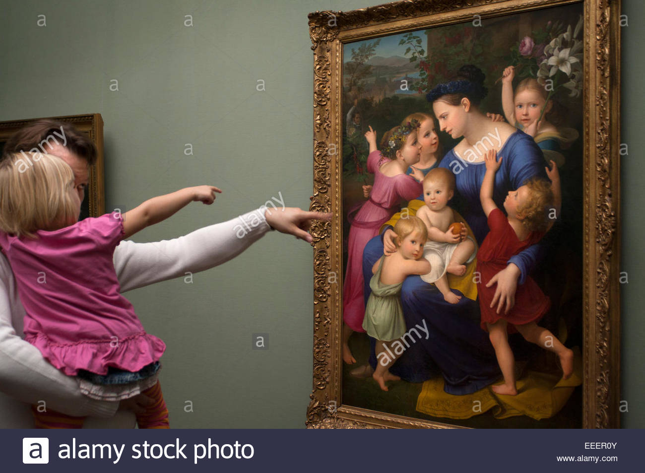A father and daughter look frescoes from the Casa Bartholdy in Rome at the Alte Nationalgalerie in Berlin Germany. - Stock Image