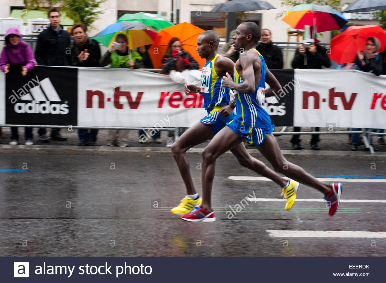 Black African participant of the Berlin Marathon at kilometer 40, Berlin, Germany, Europe. The Berlin Marathon (branded - Stock Image