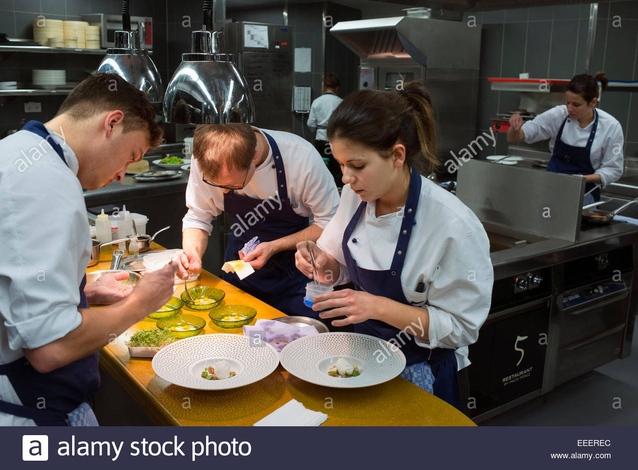 Kitchen of Das Stuen. Michelin-starred Catalan chef Paco Purez in Das Stue Restaurant. Occupying a 1930s building - Stock Image