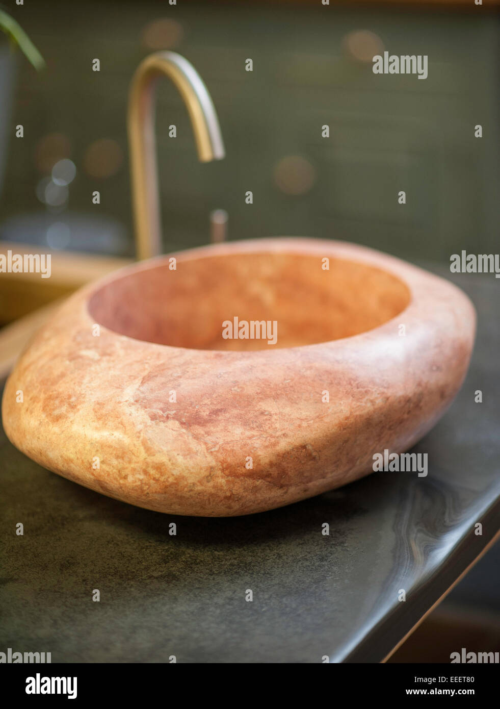 a bespoke sink made from stone - Stock Image