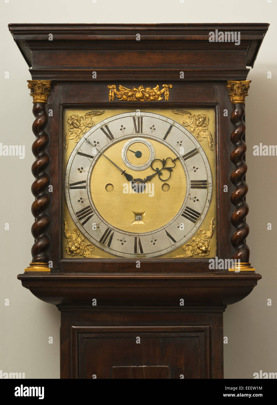 Grandfather/Grandmother clock face, with Roman numerals and twisted wood columns with Corinthian column caps. Long - Stock Image