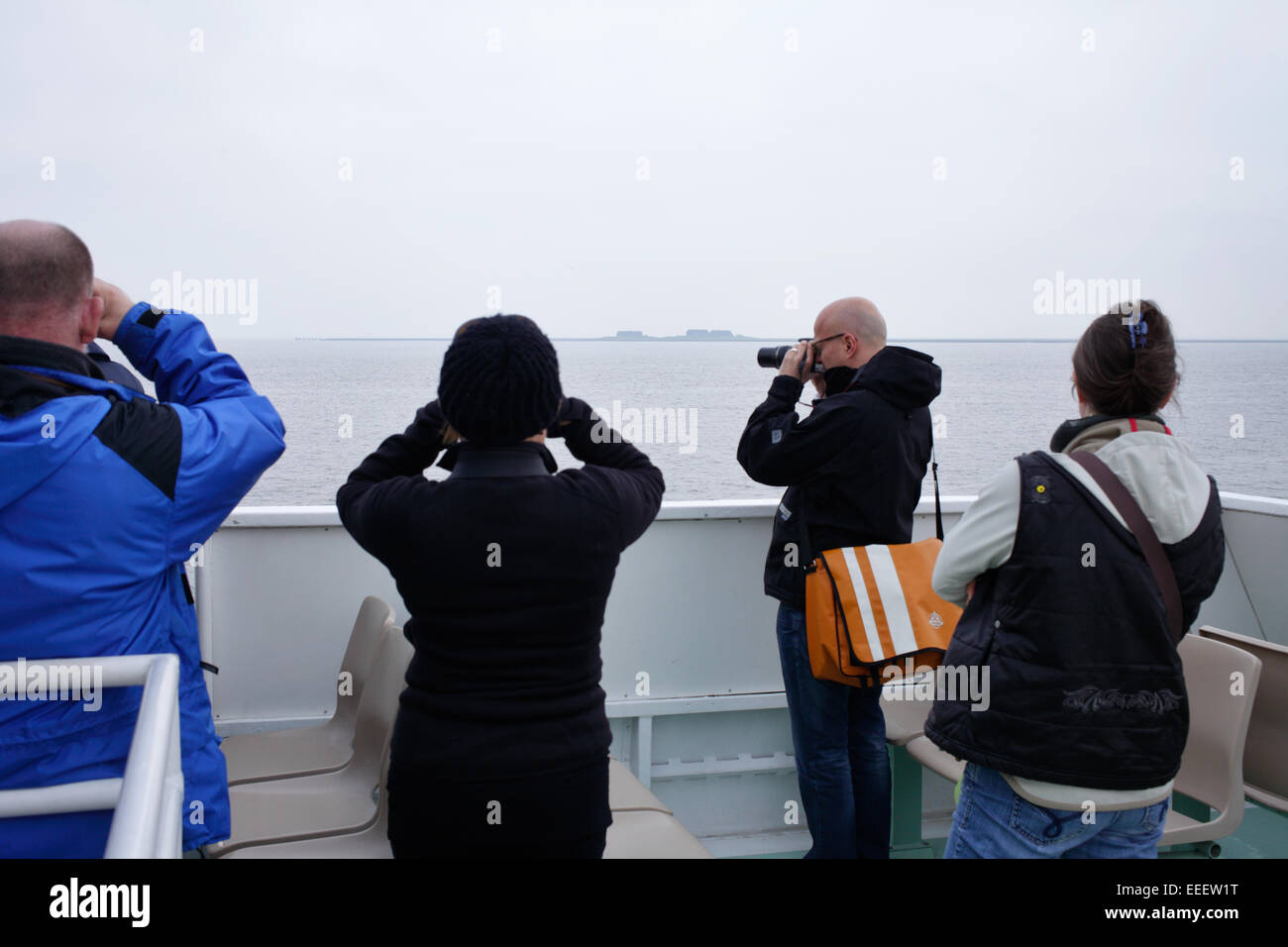 Germany, Passengers a ferry to take pictures of the islets - Stock Image