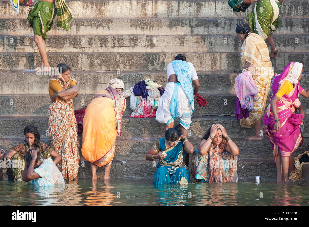9d506b36d19 Varanasi, India. Hindu women bathing and praying in the Ganges river ...