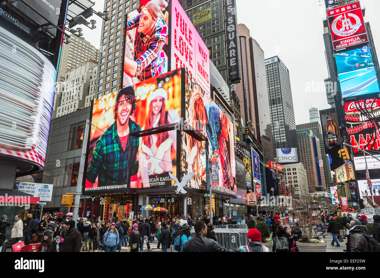 Times Square, New York, with brightly illuminated American Eagle Outfitters store and advertisements - Stock Image