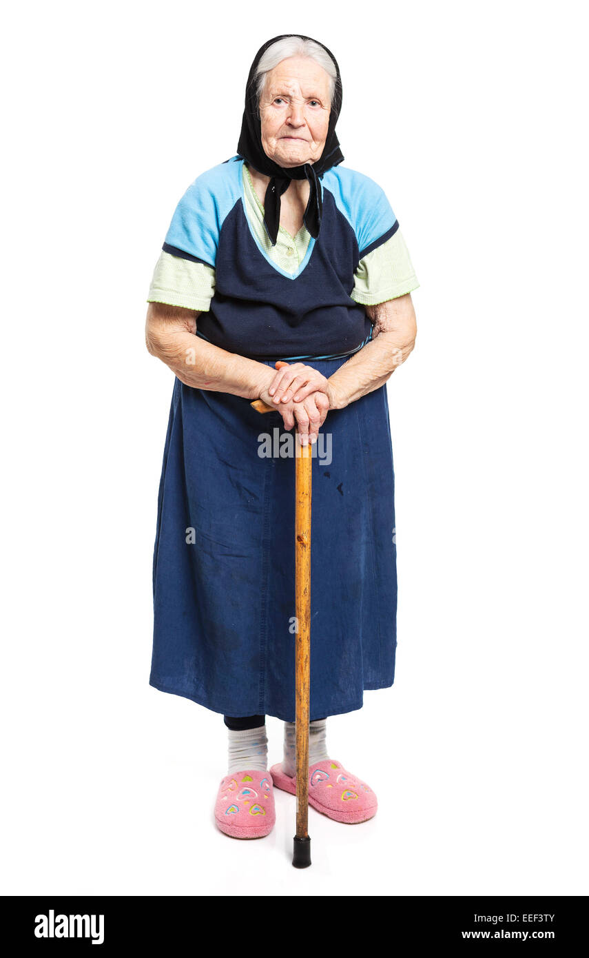 Old woman with a cane on a white background - Stock Image