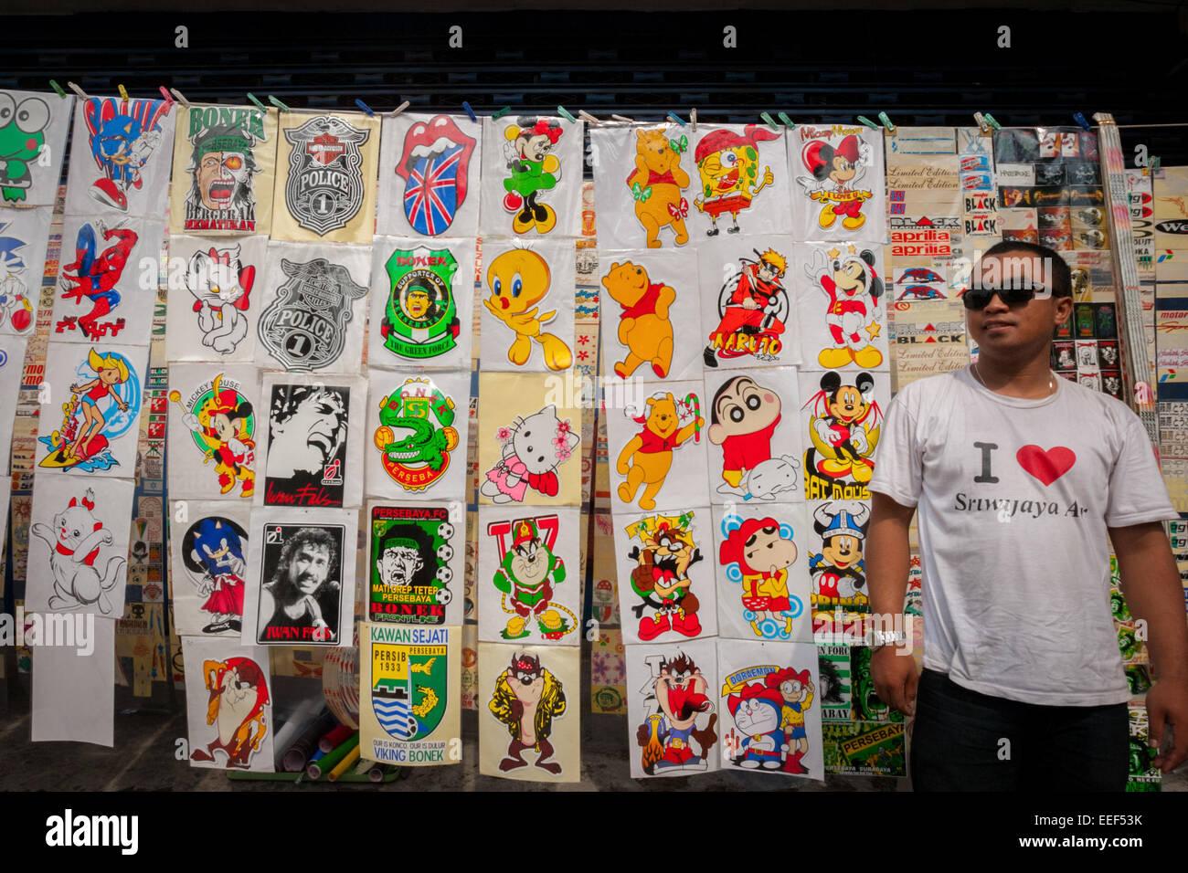 Unofficial fictional character stickers vendor at Surabaya Sunday market near Tugu Pahlawan (heroes monument). - Stock Image