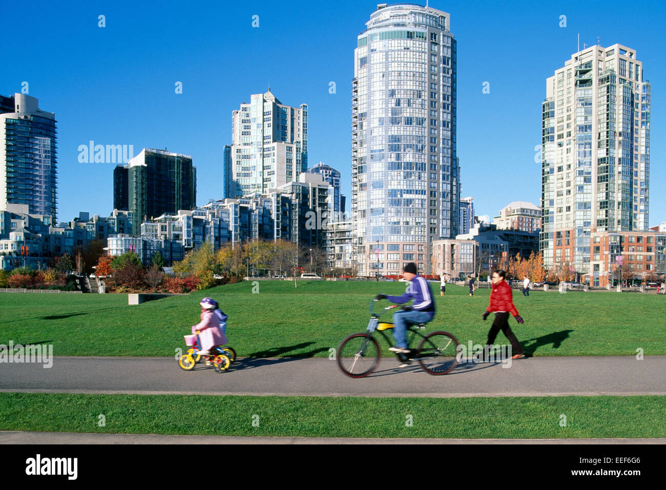 Yaletown, Vancouver, BC, British Columbia, Canada - Family cycling and walking on a Path through David Lam Park, Stock Photo
