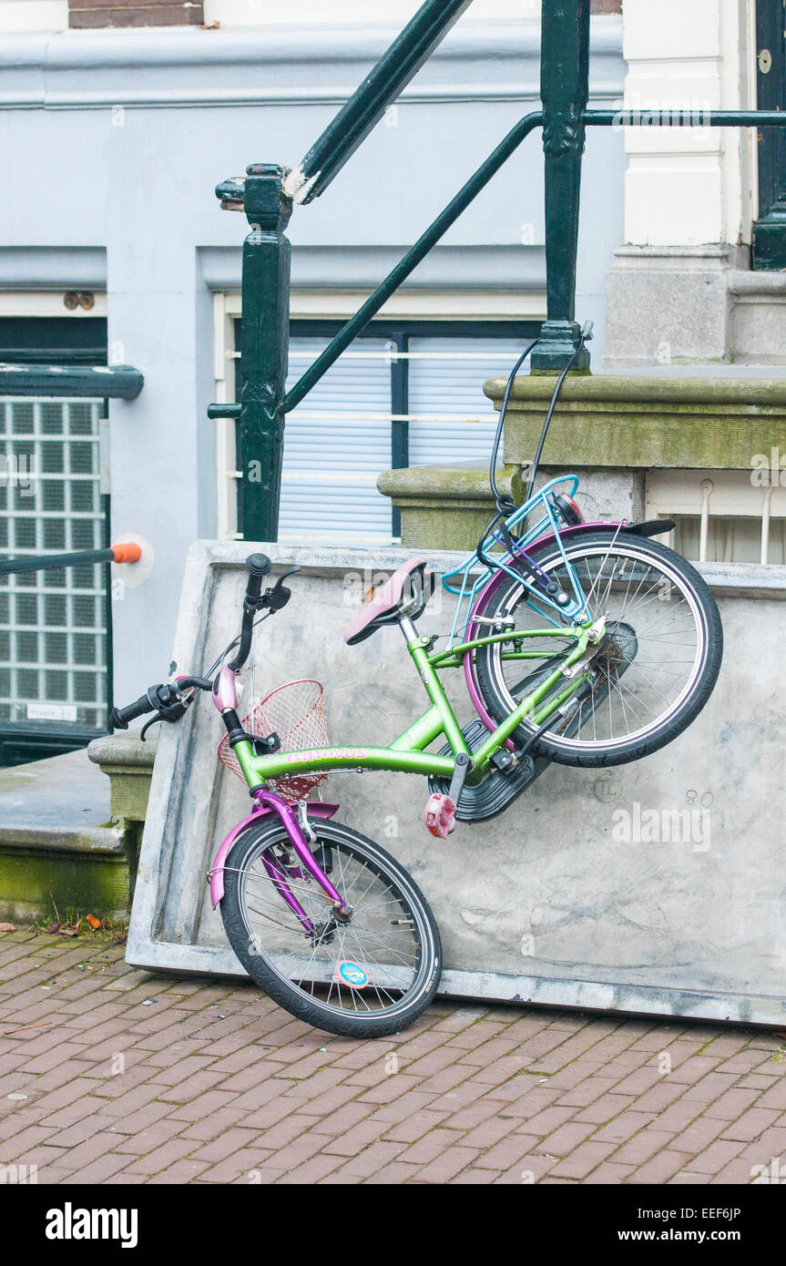 Bicycle chained outside a house in Amsterdam, This is an iconic picture of the most recognizable feature of the - Stock Image