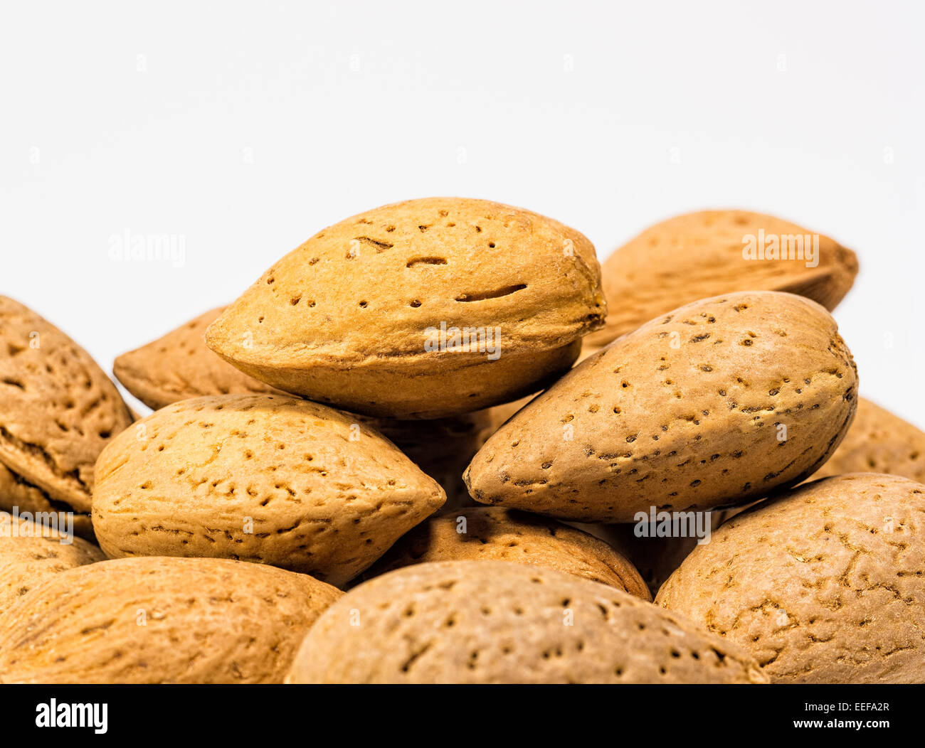 Almonds with white background - Stock Image