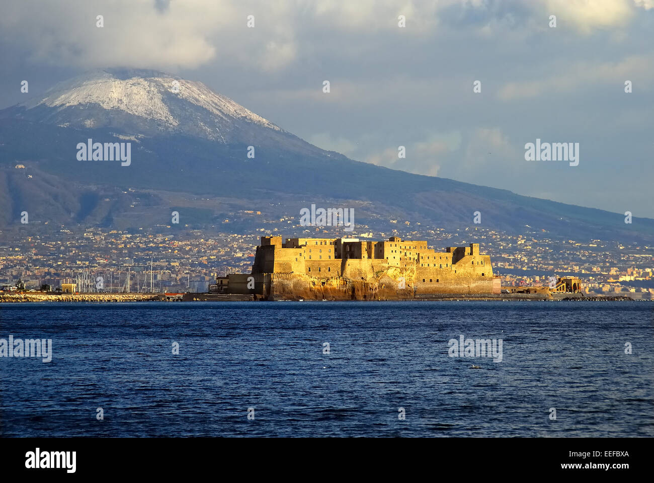 Naples, Italy. Gulf of Naples, Castel dell'Ovo and Vesuvius  with snow. - Stock Image