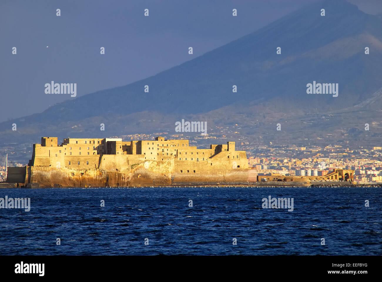 Naples, Italy. Gulf of Naples, Castel dell'Ovo and Vesuvius. - Stock Image