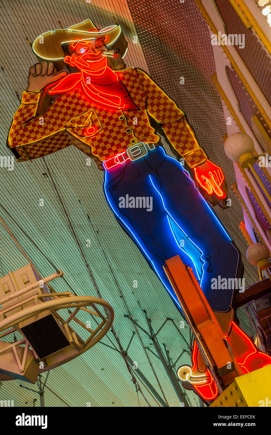 Vic Vegas neon cowboy, Fremont Street Experience pedestrian mall, Las Vegas, Nevada, USA - Stock Image