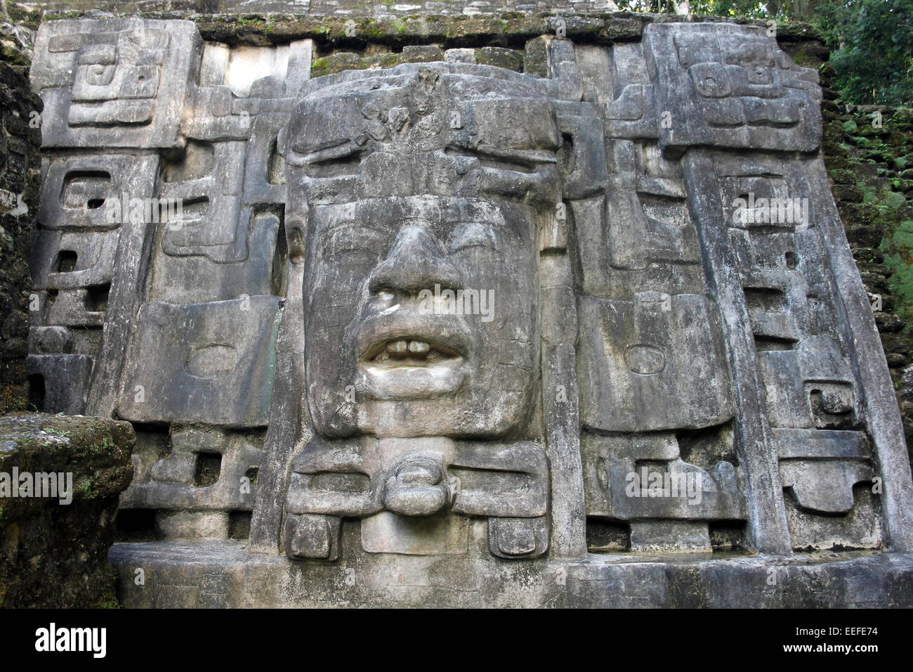 Mask Temple, Lamanai, Belize  Adorned by a 13-foot stone mask of an ancient Maya king - Stock Image