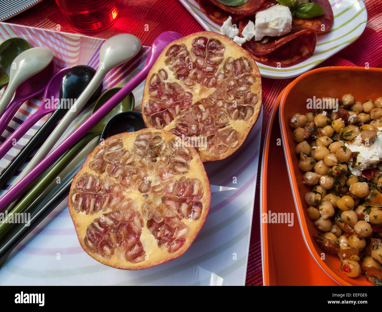 Outdoor picnic with pomegranite and chickpeas - Stock Image