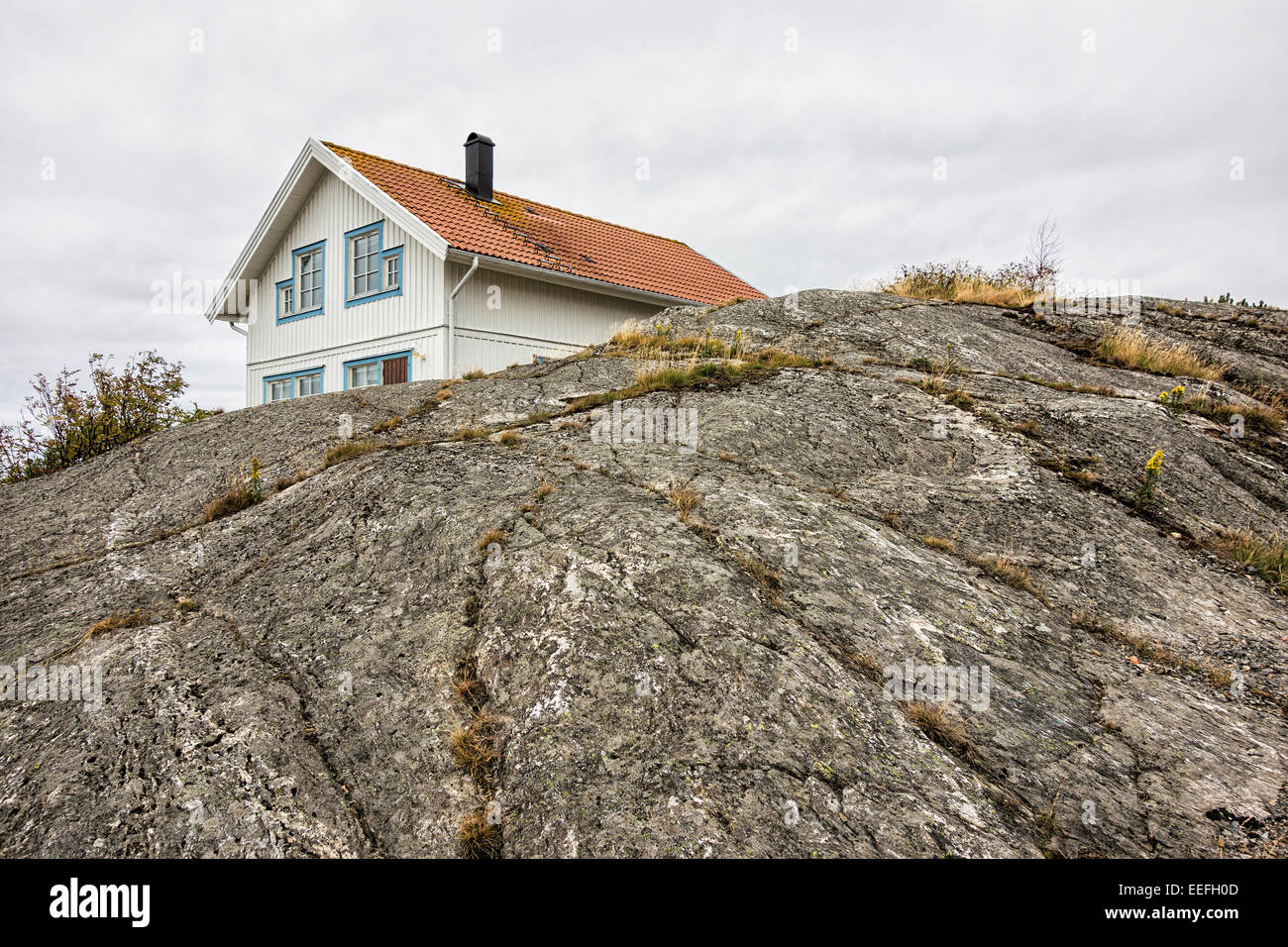 Building on a rock on the island Orust in Sweden - Stock Image