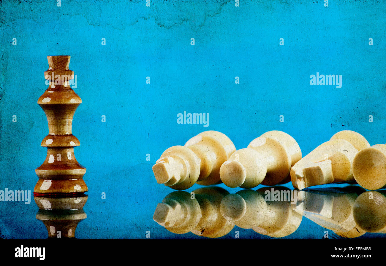 Chess pieces on blue background - Stock Image