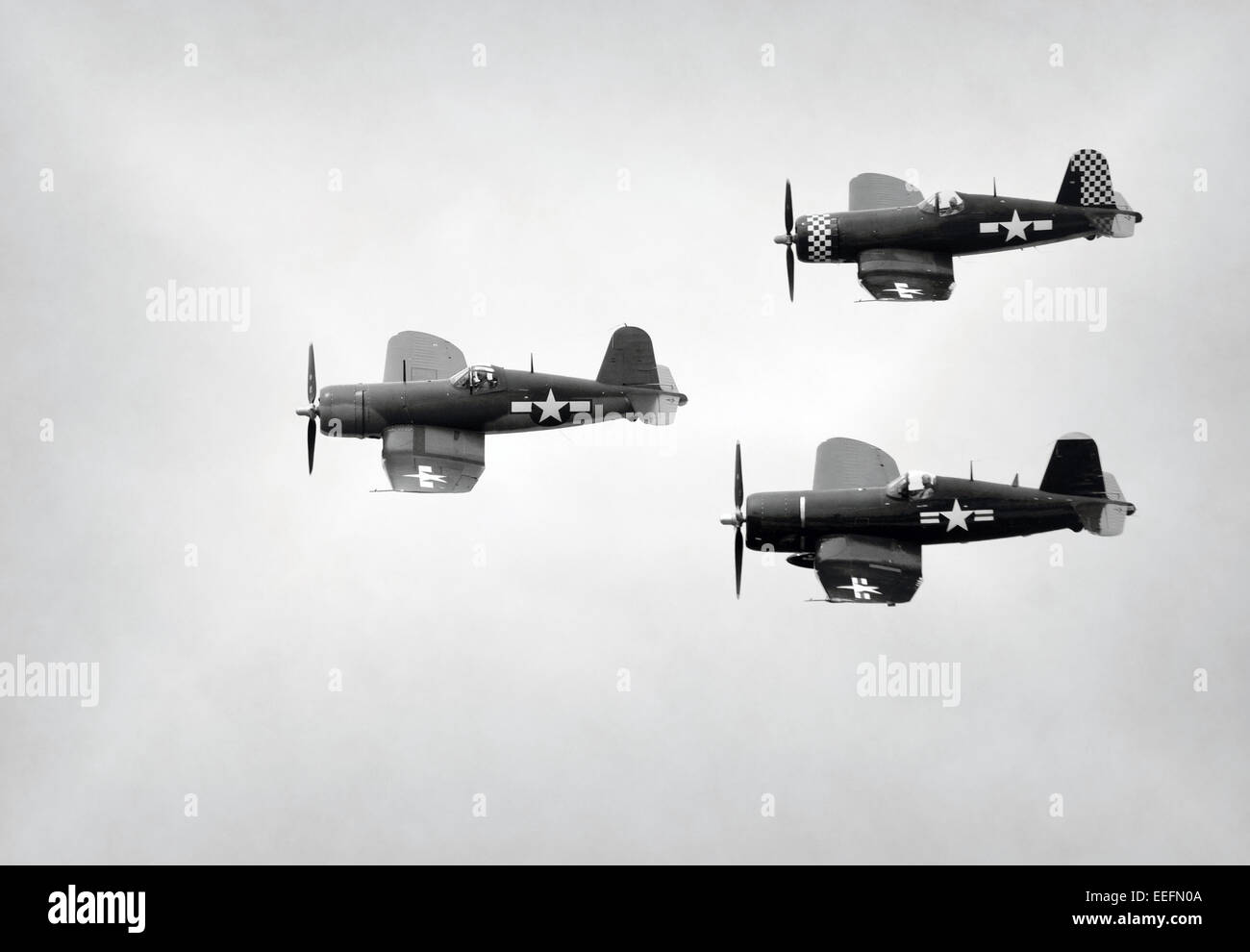 World War II era Navy fight airplanes in formation - Stock Image
