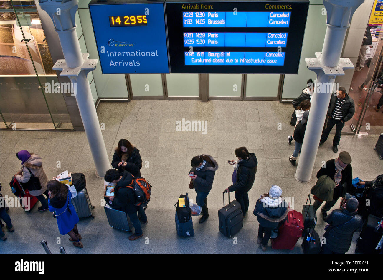 London, UK. 17th Jan, 2015. Passengers queue in St. Pancras Station, London, England UK as it is announced that Stock Photo