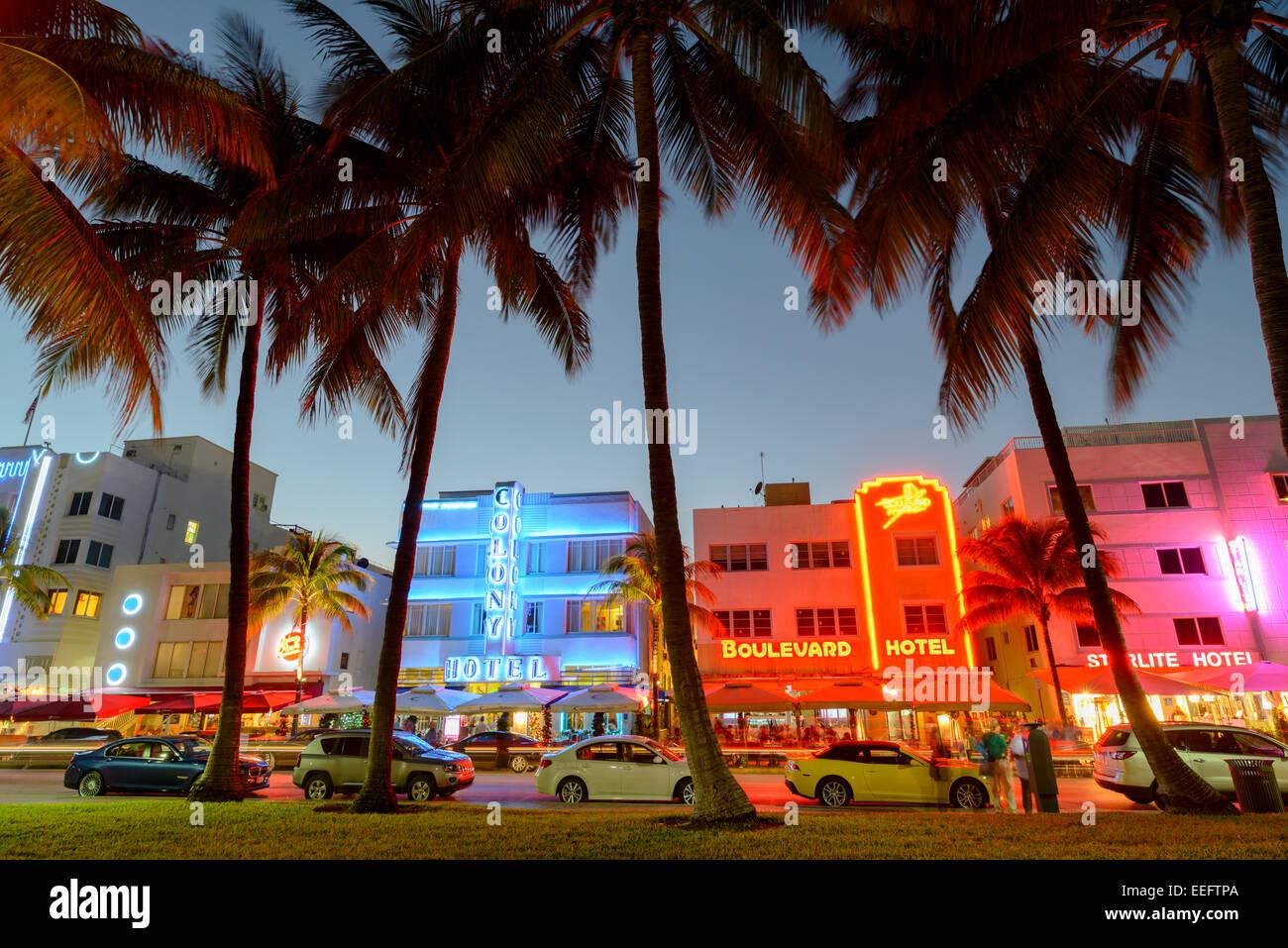 Art Deco Hotels on Ocean Drive at Dusk, South Beach, Miami, Florida, USA - Stock Image