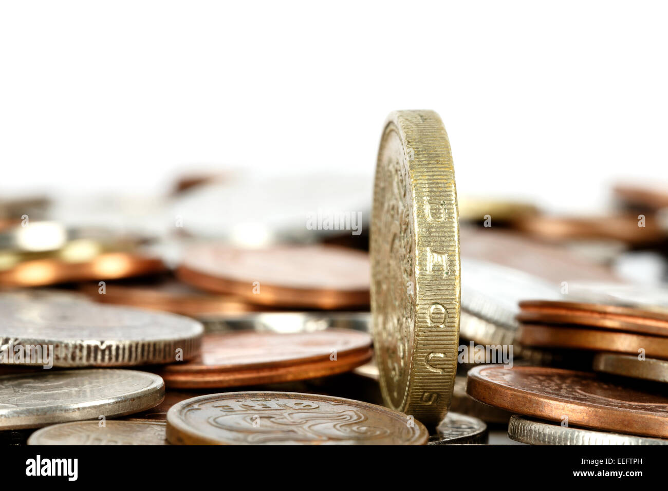 Coin towers over other - Stock Image