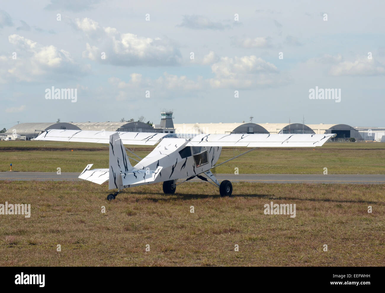 Light private airplane taxiing on the ground rear view - Stock Image