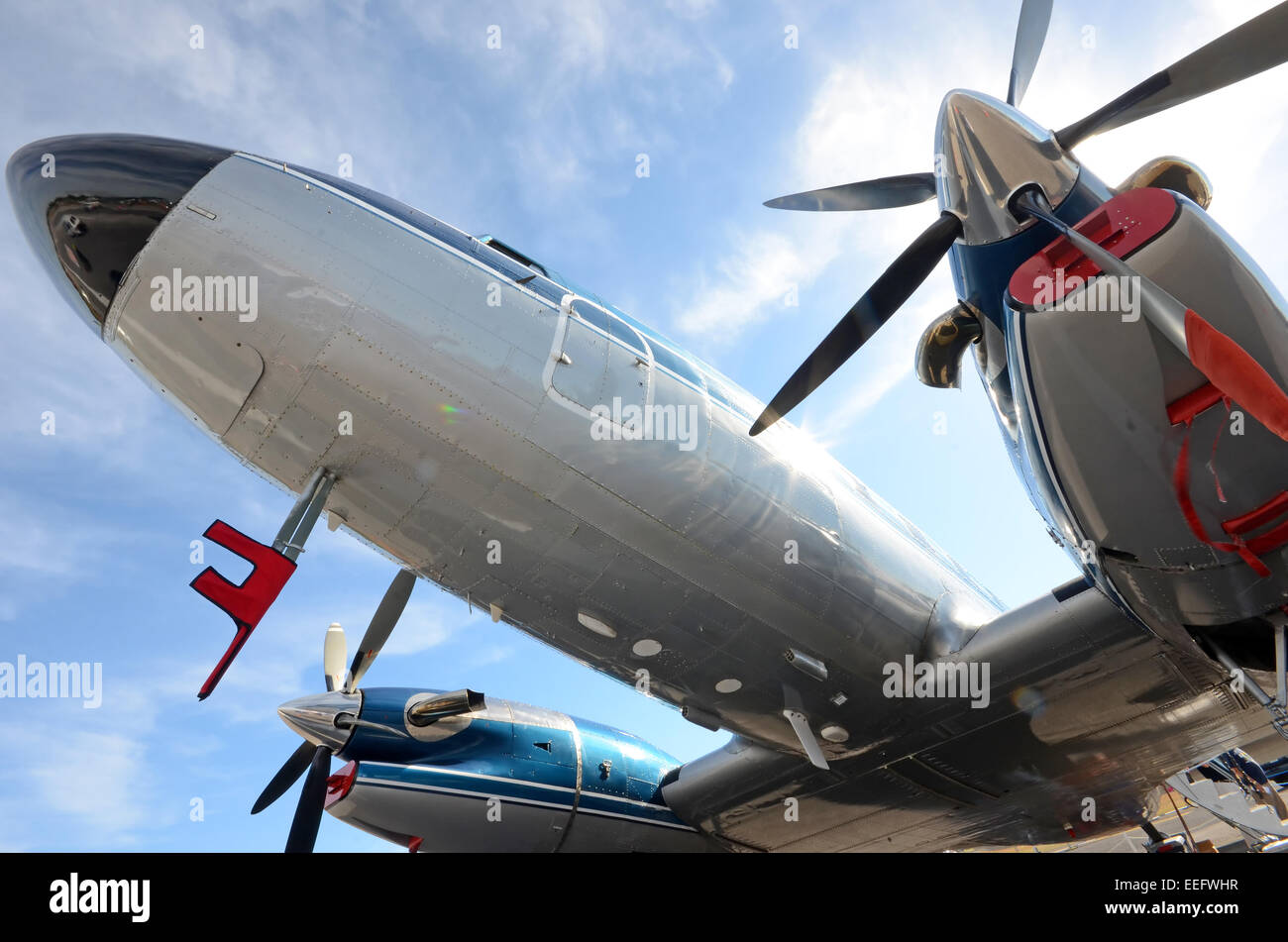 Old turboprop airplane seen from below - Stock Image