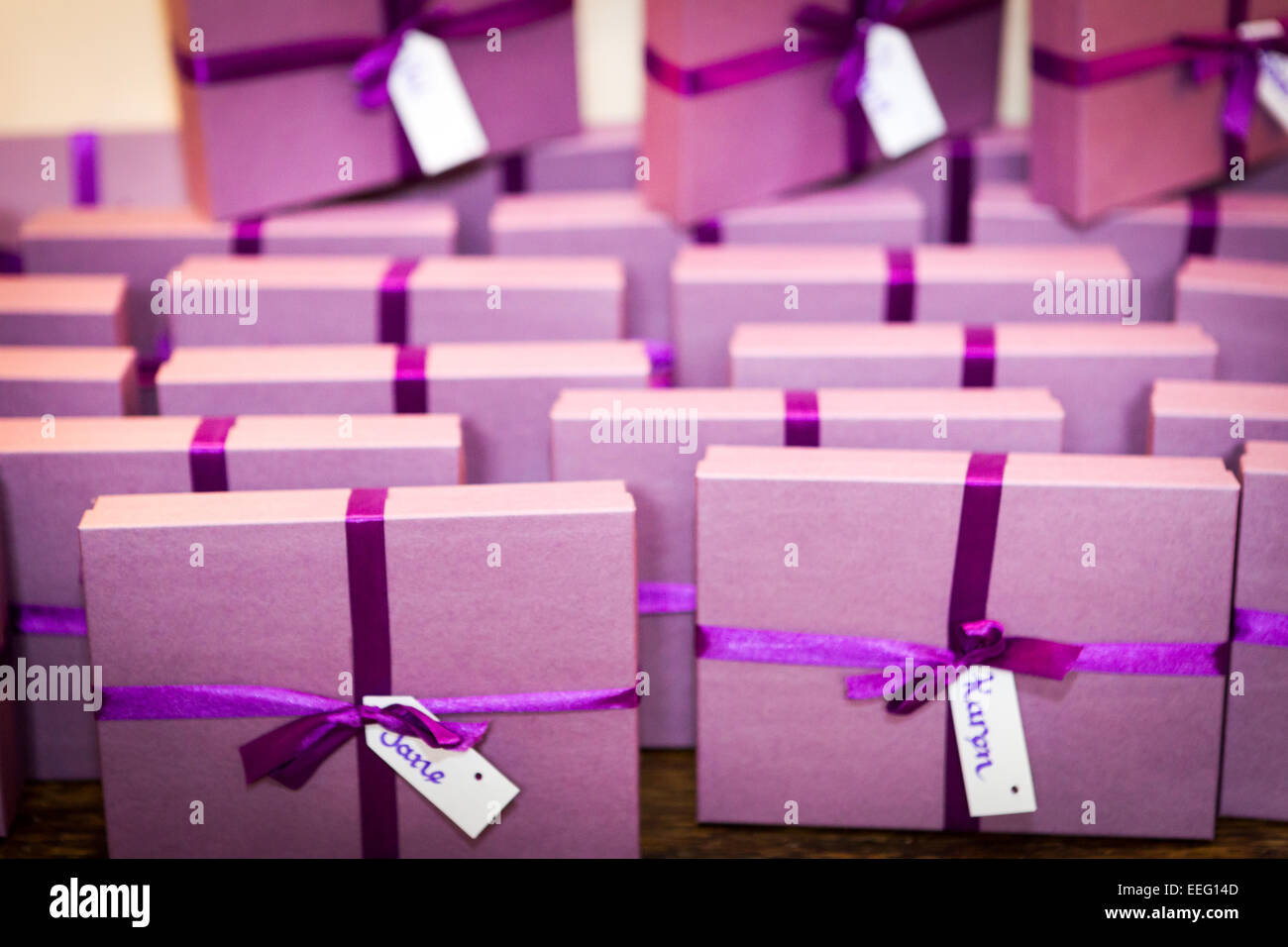 Collection of named purple gift boxes with purple ribbon Stock Photo ...