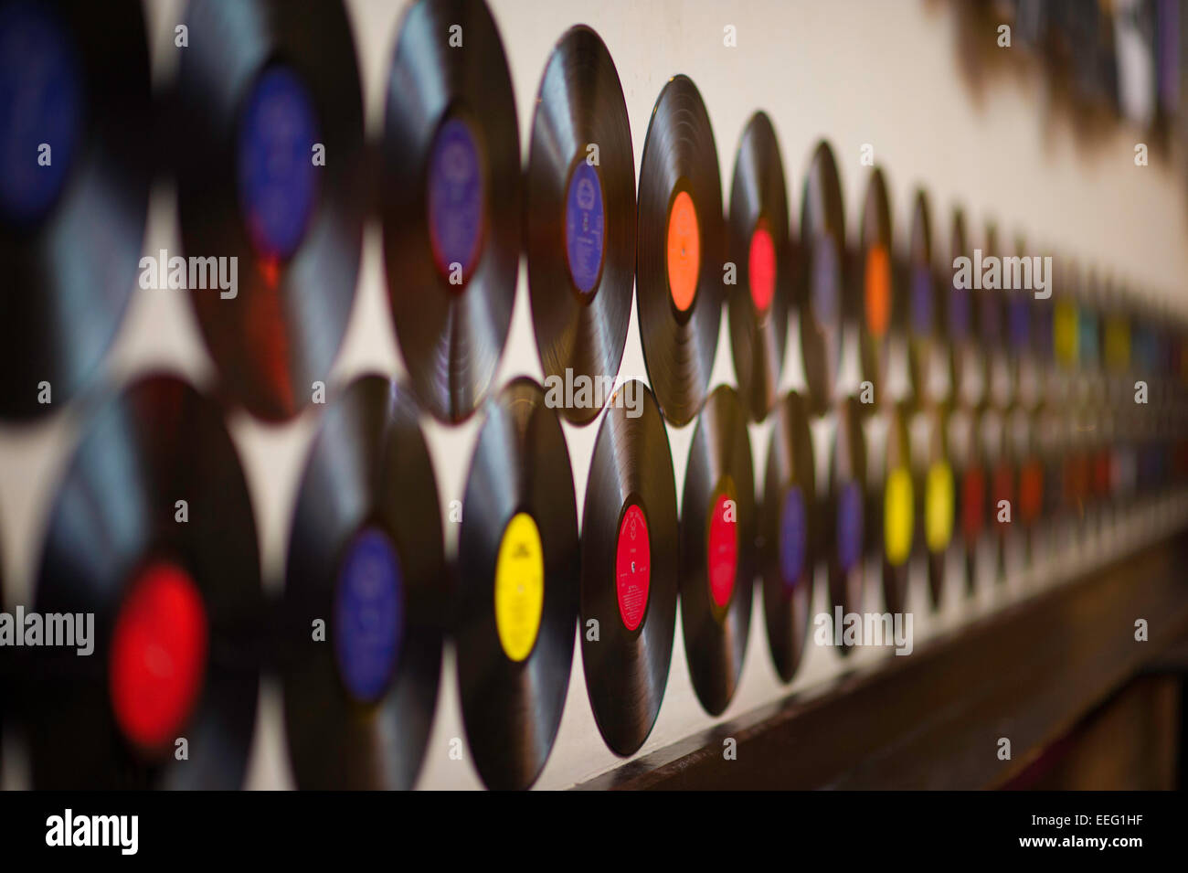 Vinyl record LP's hanging on a wall in the Brewhouse pub Cardiff - Stock Image