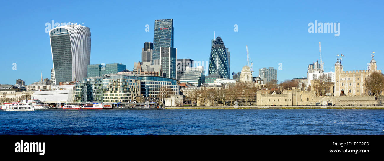 London cityscape panorama contrasting the medieval Tower of London with the modern City of London skyline - Stock Image