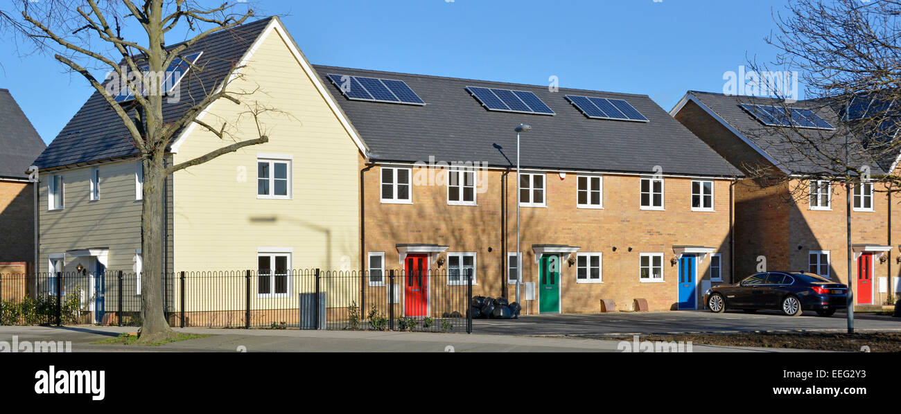 New mixed housing development nearing completion (few occupied some empty) with new solar panels installed during - Stock Image