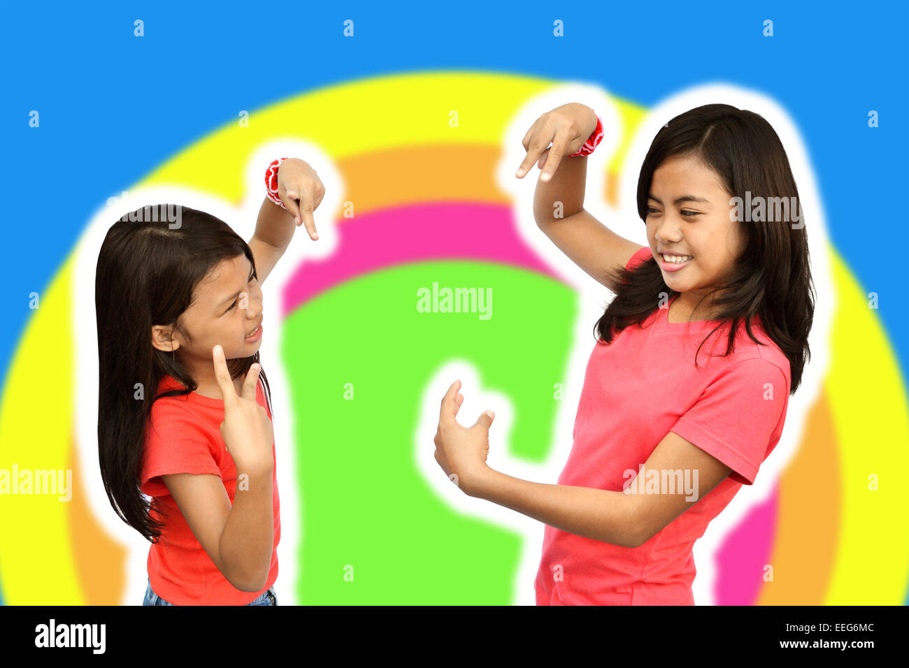 Teen young lady showing her sister how to make a cool dance moves - Stock Image