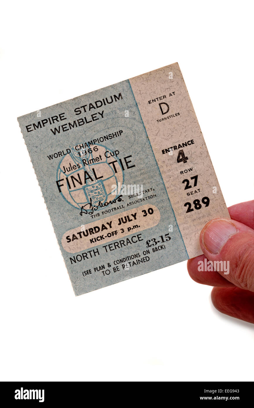 Hand holding a World Cup Final 1966 England v West Germany ticket - Stock Image