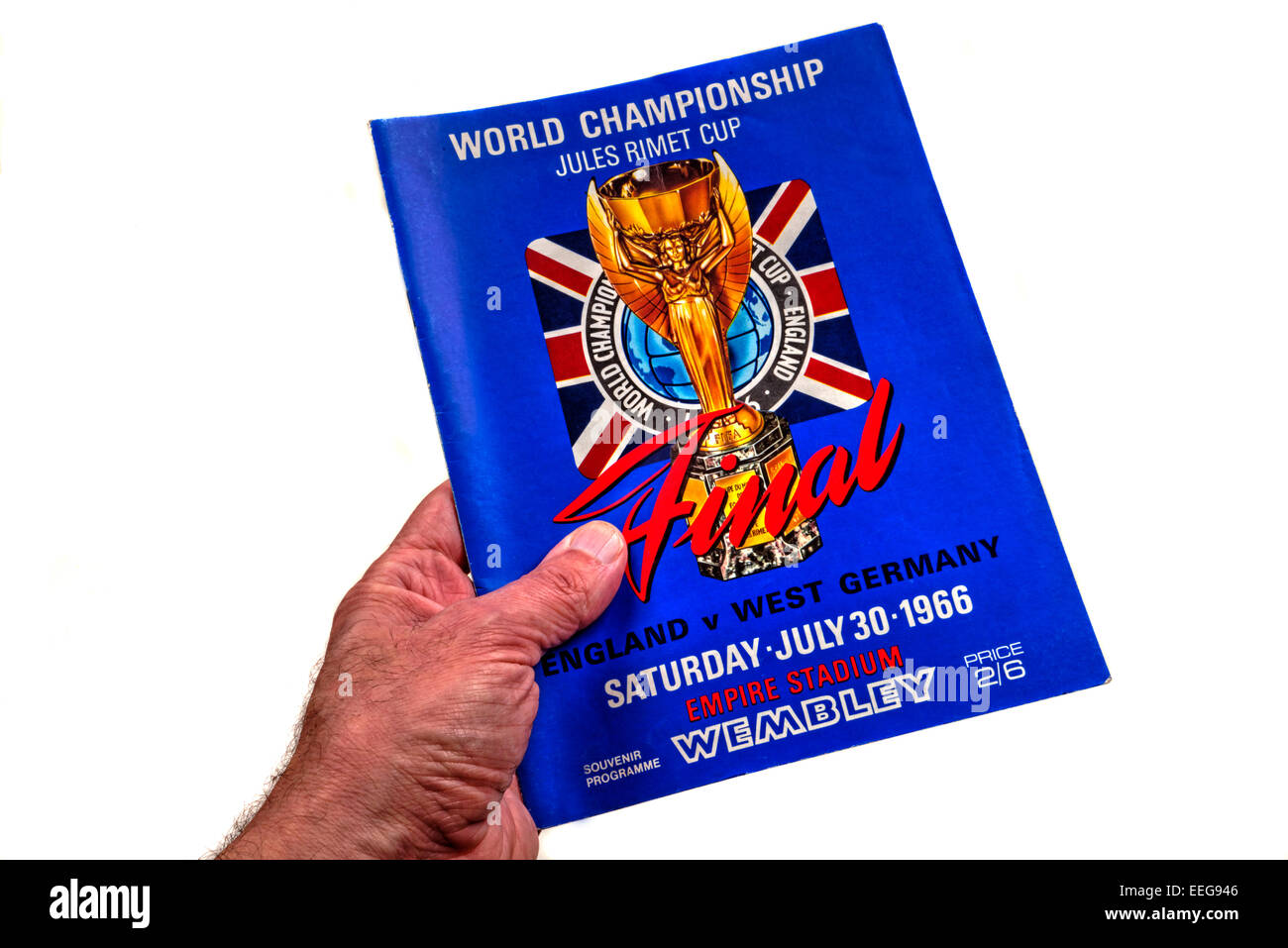 Hand holding a World Cup Final 1966 England v West Germany program (programme) - Stock Image