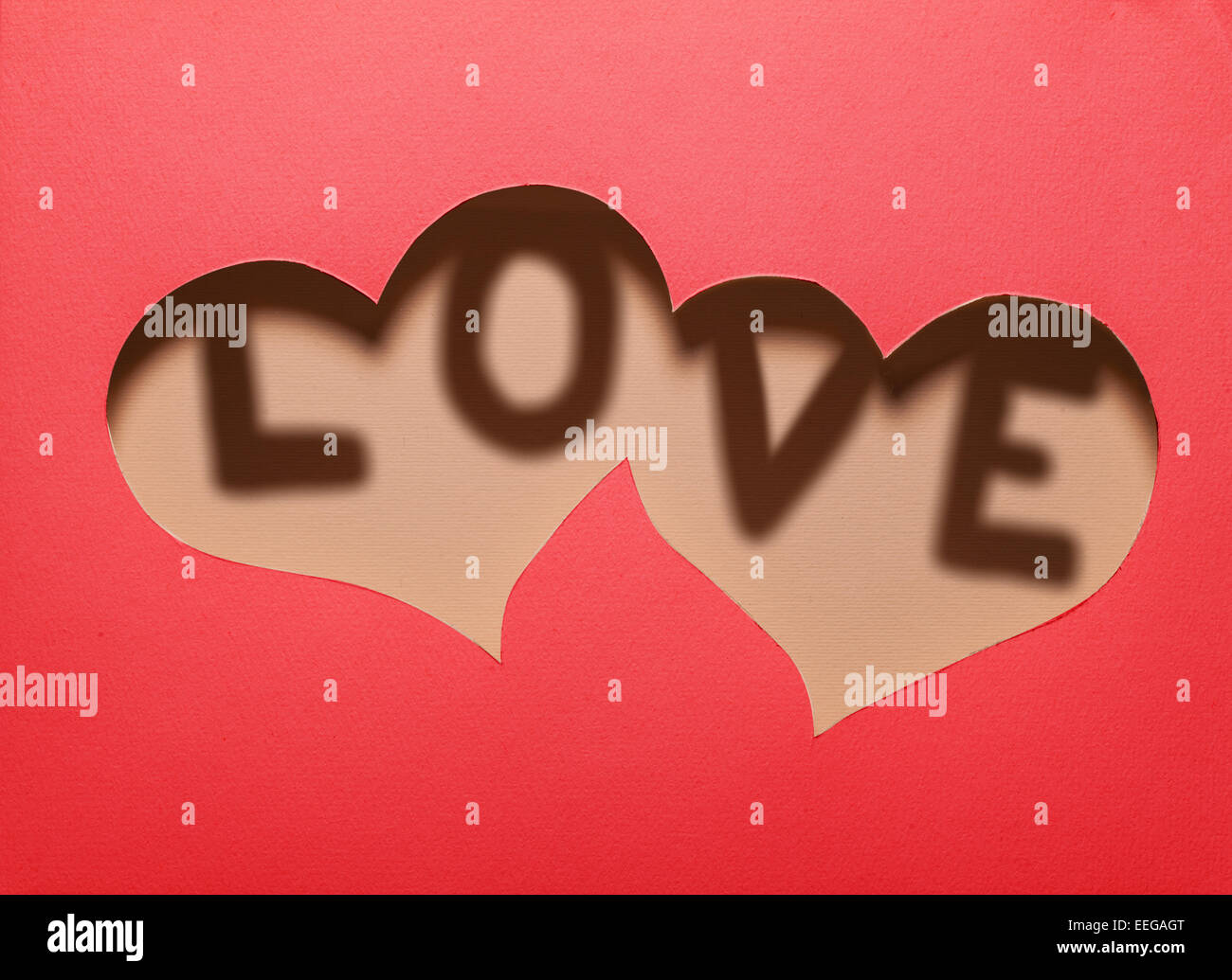 Two Hearts Cutout In Red Paper With Word Love Inside Card Design